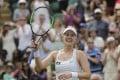 Alison Riske celebrates defeating Ashleigh Barty at Wimbledon. Photo: AP