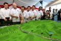 Najib Razak, Malaysia's former prime minister, looks at a model of the China-backed East Coast Rail Link project. Photo: AP