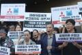 South Korean demonstrators urge a boycott of Japanese goods. Photo: EPA