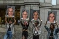 Members of a protest group called 'Hot Mess' hold up photos of Jeffrey Epstein in front of the federal courthouse in New York on Monday. Photo: AFP