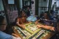 Mahjong players enjoy a game at a club in Tiretta Bazaar, one of two Chinatowns in Kolkata, India. Photo: Jennifer Kishan