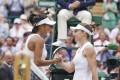 Zhang Shuai and Simona Halep shake hands after their Wimbledon quarter-final. Photo: Kyodo