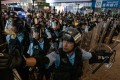 Police officers in action at an anti-extradition rally on July 7 in Mong Kok. The police watchdog, the IPCC, is setting up a special panel to look into complaints of police brutality, but it is likely that most protesters would not trust its findings. Photo: Getty Images/TNS
