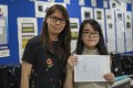 Daisy Kwok (right), who suffers from hypotonia, with her class teacher Ma Ting-ting at Hong Kong Red Cross Princess Alexandra School in Kwun Tong on Wednesday. Photo: Tory Ho