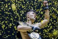 Christian Lee celebrates winning the title against Shinya Aoki in Singapore. He says he wants to defend the belt this year. Photos: One Championship