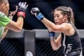 Angela Lee squares up to Xiong Jingnan, who she faces in a rematch in October. But first she has to get past Michelle Nicolini – whom she has a score to settle with. Photos: One Championship