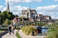 France offers tantalising sights for those who might be following the Tour de France, and want to see more. Here, visitors cycle towards Abbey of Saint-Germain d'Auxerre beside the River Yonne in Auxerre. Photo: Alamy