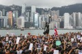 Anti-extradition bill protesters in Tsim Sha Tsui march to the high-speed rail link terminus in West Kowloon on July 7. Photo: Felix Wong