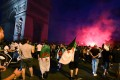 Algerian football fans celebrate the victory of their team near the Arc de Triomphe in Paris. Photo: AFP