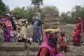 Women and children at a brick factory in Uttar Pradesh. Photo: Miguel Candela