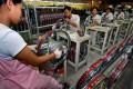 Manufacturers complain that as well as not having China's famed production capacity and labour efficiency, in Vietnam, they cannot safeguard their asset investments and have to put up with increasingly strict environmental and social security requirements. Photo: Xinhua