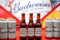 Budweiser beer products manufactured by Anheuser-Busch InBev NV sit on display during a news conference in Hong Kong on July 4, 2019. Photo: Bloomberg