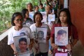 Relatives of drug war victims at a memorial mass in Manila on July 9, 2019. Photo: AFP