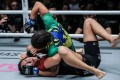 Michelle Nicolini punches Angela Lee on the ground. The Brazilian got a unanimous decision win in Kuala Lumpur. Photos: One Championship