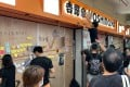 Protesters in Sha Tin leave messages at a Yoshinoya outlet, which had boarded its windows ahead of a anti-extradition bill rally. Photo: Zoe Low
