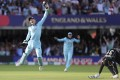 England's Jos Buttler celebrates after running out New Zealand's Martin Guptill to swal the World Cup for the hosts. Photo: AP
