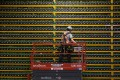 A technician inspects bitcoin mining systems at Bitfarms in Saint Hyacinthe, Quebec. File photo: AFP