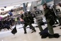 Riot police use pepper spray to disperse pro-democracy activists inside New Town Plaza mall. Photo: Reuters