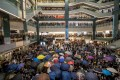 Demonstrators gather in the atrium of the New Town Plaza shopping mall on Sunday night. Photo: Bloomberg