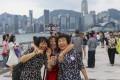 Mainland Chinese tourists visit the Avenue of Stars at Victoria Harbour in Tsim Sha Tsui, Hong Kong. Photo: Sam Tsang
