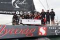 The Scallywag crew pose on the deck of their super maxi 100-footer after taking line honours in the Transatlantic Race 2019. Photo: Rick Tomlinson