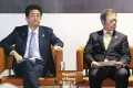 Japanese Prime Minister Shinzo Abe and South Korean President Moon Jae-in attend an event on the sidelines of the Asia-Pacific Economic Cooperation forum summit in Papua New Guinea in November 2018. Under the conservative Abe and progressive Moon, relations between Japan and South Korea have reached their lowest point in decades. Photo: Kyodo
