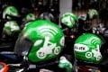 FILE PHOTO: Gojek driver helmets are seen during Go-Food festival in Jakarta, Indonesia, October 27, 2018. REUTERS/Beawiharta/File Photo