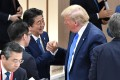 Japanese Prime Minister Shinzo Abe shakes hands with US President Donald Trump at the G20 Summit in June. Photo: Reuters