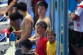 China's Sun Yang (top C) attends a training session with coach Denis Cotterell (foreground). Photo: AFP