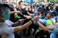 Protesters clash with police after a march against parallel trading by mainland Chinese visitors in Sheung Shui on July 13. Photo: Felix Wong