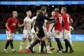 Players from Manchester United and Leeds United scuffle during their friendly match. Photo: AP