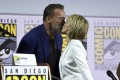 Arnold Schwarzenegger and Linda Hamilton kiss at Comic-Con, where they took part in a discussion about Terminator: Dark Fate, the latest film in the Terminator franchise. Hamilton, last seen in Terminator 2, is reprising her role as Sarah Connor. Photo: Chris Pizzello/Invision/AP