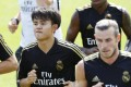 Real Madrid's Takefusa Kubo (left) alongside Gareth Bale at the team's training camp in Montreal, Canada. Photo: Kyodo