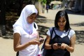 Students use their mobile phones at the Witwatersrand University in Johannesburg, South Africa. In the first quarter of this year Africa's smartphone shipments declined 7.1 per cent quarter on quarter to 21.5 million units. Photo: AFP