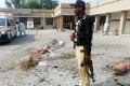 A Pakistani policeman stands guard at the site of the blast. Photo: AFP