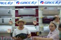 GREE air conditioners are on sale in a Gome electrical appliances store in Beijing. Photo: Alamy