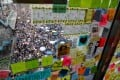 """Demonstrators seen through a """"Lennon wall"""" plastered with colourful notes supporting the protests, as marchers rally for democratic reforms in Hong Kong on July 21. Photo: Reuters"""