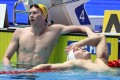 China's Sun Yang reacts next to Australia's Clyde Lewis after winning the final of the men's 200m freestyle. Photo: AFP