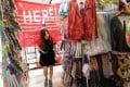 A customer hunts for bargains at a discount retail shop in Tsim Sha Tsui on July 12. Photo: May Tse