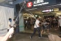 A mob of men in white T-shirts attack people at the Yuen Long MTR Station. Photo: SCMP Pictures