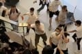 Men in white brandishing sticks and metal rods had attacked commuters at Yuen Long MTR station on Sunday. Photo: Handout