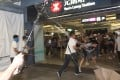 A mob of men in white T-shirts attack protesters and passengers at Yuen Long MTR station. Photo: SCMP