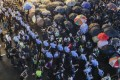Police lines hold back protesters at an action in Tsim Sha Tsui. Photo: Edmond So