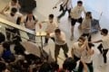 A mob of men in white T-shirts chases and brutally assaults passengers and protesters returning home, at Yuen Long MTR station late on July 21. Especially targeted were those wearing black, the colour of the anti-extradition protests. Photo: Handout