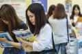 Job seekers fill in forms at a job fair at Kai Tak Shopping Centre in Lam Tin in September 2018. More universities means more graduates seeking jobs but what happens when there aren't enough jobs to go around? Photo: Nora Tam