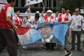 South Korean protesters cut a banner showing a picture of Japanese Prime Minister Shinzo Abe at a rally. Photo: AFP