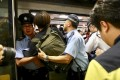 Police restrain protesters trying to prevent Chai Wan-bound trains from leaving the Admiralty MTR station by obstructing train doors during the morning rush hour of July 24. The protesters were taking part in a non-cooperation campaign against MTR Corp to seek accountability over violent attacks on passengers at Yuen Long station on July 21. Photo: Nora Tam