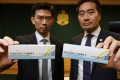Lot Chan (left), chief pharmacist at the Department of Health's drug office, with a box of genuine vaccine and Kwan Kin-keung, head of intellectual property investigation bureau at the Customs and Excise Department, shows what is believed to be a box of counterfeit vaccine at an earlier press meet. Photo: May Tse