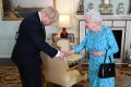 Queen Elizabeth welcomes Boris Johnson during an audience in Buckingham Palace. Photo: Reuters