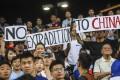 Protesters at the match between Kitchee and Manchester City at Hong Kong Stadium. Photo: K.Y. Cheng